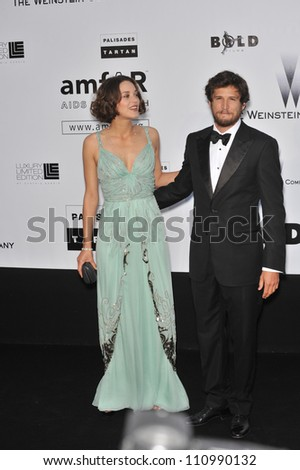 ANTIBES, FRANCE - MAY 21, 2009: Marion Cotillard & Guillaume Canet at amfAR's Cinema Against AIDS Gala at the Hotel du Cap d'Antibes. May 21, 2009  Antibes, France