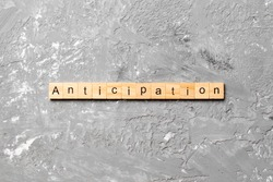 anticipation word written on wood block. anticipation text on cement table for your desing, concept.