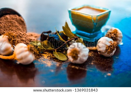 Antidote for wounds and cuts on wooden surface i.e. Devil's dung powder well mixed with garlic.Entire raw ingredients present on the surface. Photo stock ©