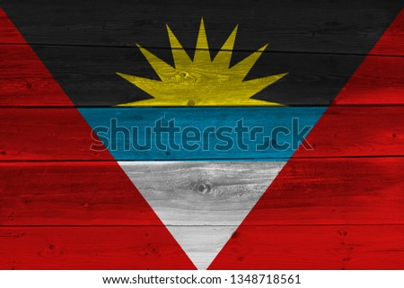 Antigua and Barbuda flag painted on old wood plank. Patriotic background. National flag of Antigua and Barbuda