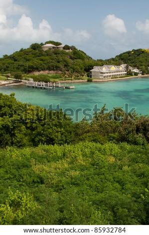 Antigua Long Bay, gorgeous seascape view surrounded by tropical nature and some typical houses