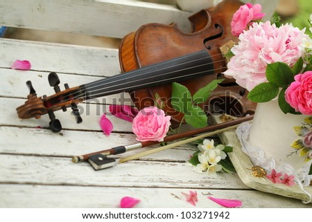 antigue violin, notes and spring bouquet