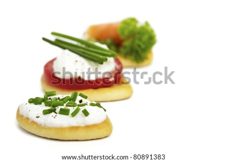 Antipasti biscuits with curd, tomato and salmon