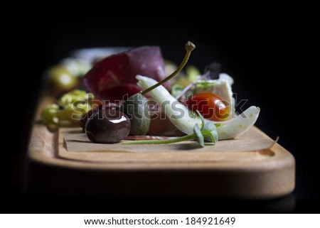 Antipasto and catering platter with different meat and cheese products
