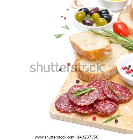 antipasto - salami, bread, olives, tomatoes isolated on white background