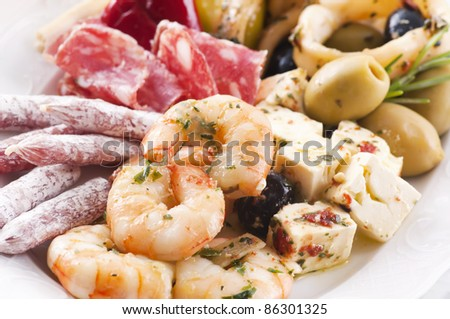 Antipasto with seafood and dry sausages