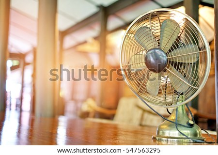 Antique and old electronic metal fan in vintage house thailand #547563295