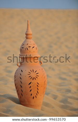 antique art old arabic pot in sand