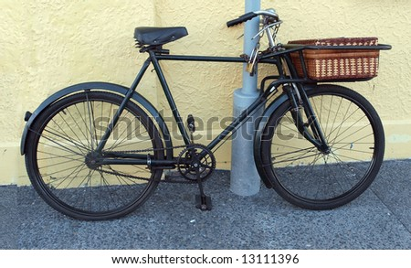 Antique Baker's Bike Chained to a pole
