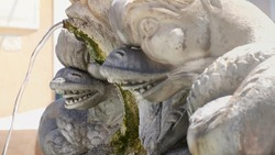 Antique baroque marble fountain with monster heads in Rome near Pantheon side view