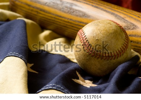 Antique baseball and bat on vintage american flag inspired bunting