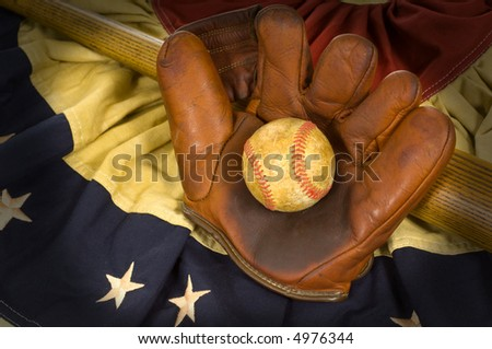 Antique baseball glove, ball and bat on vintage american flag inpired bunting