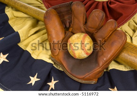 Antique baseball glove, ball and bat on vintage american flag inspired bunting - stock photo