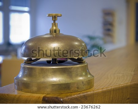 Antique bell on a counter.