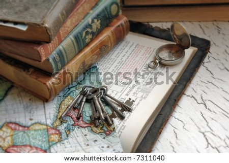 Antique Bible with keys and a map. - stock photo