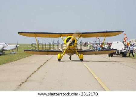 Antique biplane taxing on runway