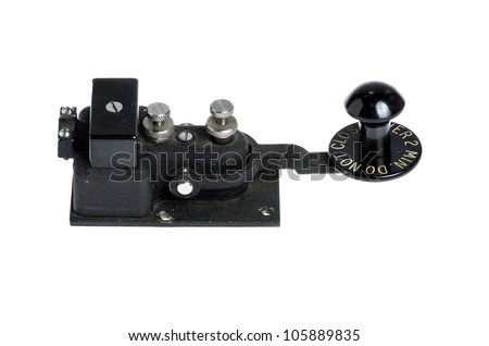 Antique black telegraph key isolated on white