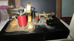 Antique black telegraph machine with light dusting