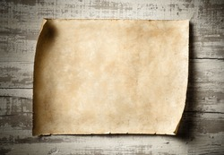 antique blank parchment on aged wooden wall