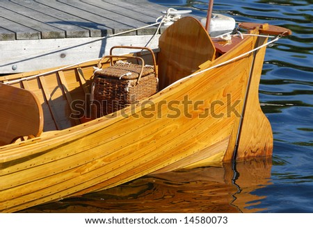 Antique boat with picnic basket in the stern