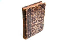 Antique book cover on white background, selective focus