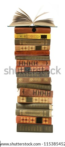 Antique book pile with open book in top isolated on white background
