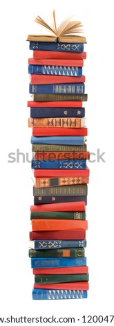 Antique book stack with open book on the top isolated on white background