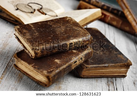 antique books on aged white table