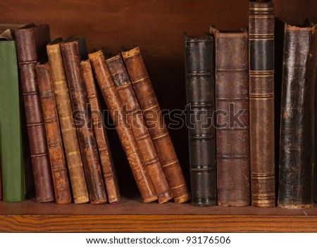 Antique books on bookshelf - stock photo