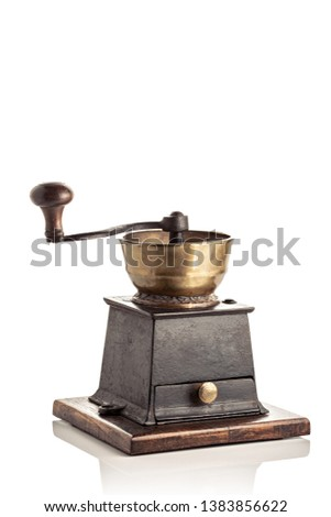 Antique Brass and cast iron coffee grinder isolated on white background. Copy space #1383856622