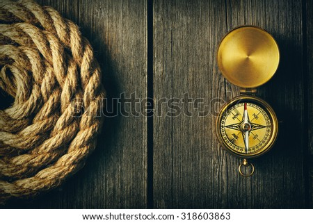 antique brass compass and rope...