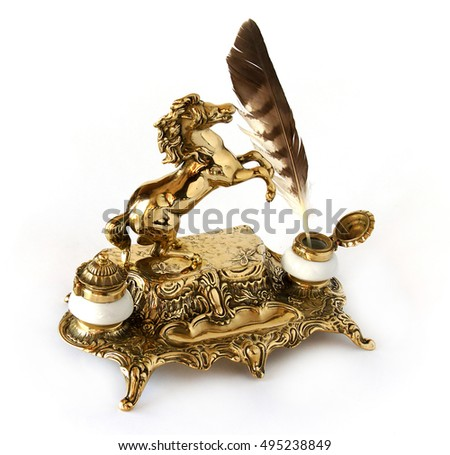 Antique brass inkwell with feather and a figure of a horse