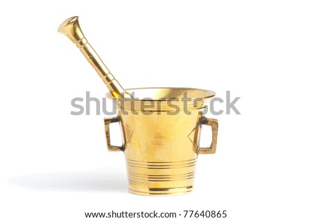 Antique brass mortar and pestle set over white background