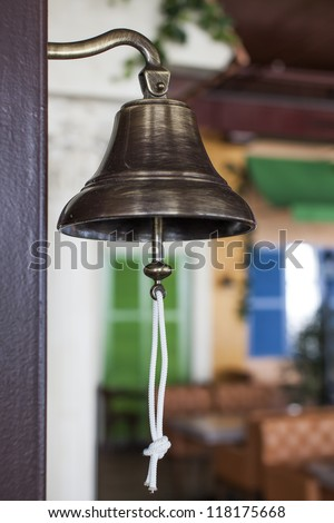 Antique brass ship's bell with a rope
