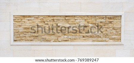 Antique brick wall with natural slim stone frame background. Stone wall texture, slim bricks.