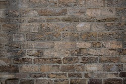 Antique brickwork wall. Masonry of ancient half-destroyed wall. Abstract texture or background.