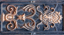 antique bronze bas-relief of the metal as a background