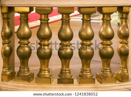 Antique bronze figured balusters, decorative fencing, a part of ancient cathedral interior
