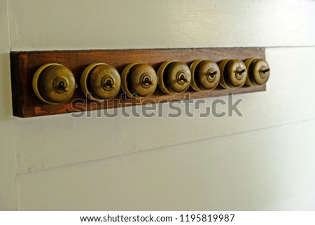 Antique bronze light switches In Retro Electrical Equipment. #1195819987