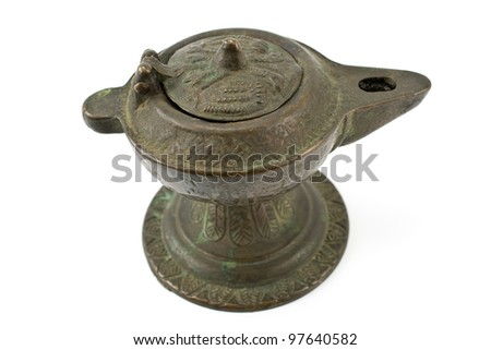 Antique bronze oil lamp isolated on white
