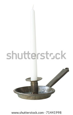 Antique candlestick with white candle isolated on white background