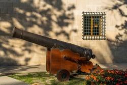 Antique cannon guarding the entrance of the public building El Consolat de Mar, seat of the Balearic government, Palma de Mallorca