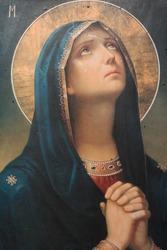 antique catholic icon representing virgin mary praying