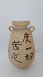 Antique ceramic art pottery, the 5 Chinese characters mean