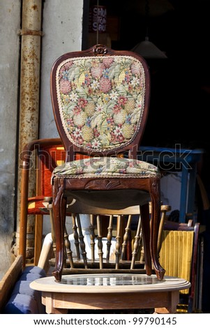 Antique chair on a table at market