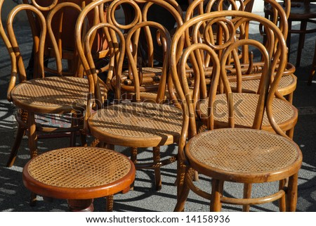 Antique chairs in a flea market - stock photo
