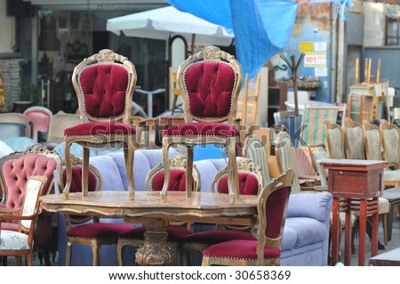 Antique Chairs on a table at flea market of Tel-Aviv