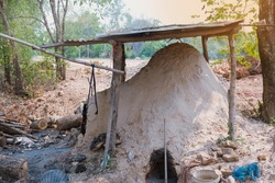Antique charcoal kiln made from clay, used for burning charcoal,  Thailand.