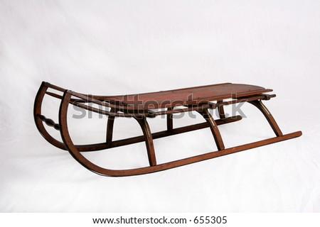 Trineo del niño antiguo hecho de la madera