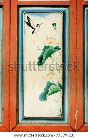 Antique Chinese art painting on wood wall of ancient chinese temple